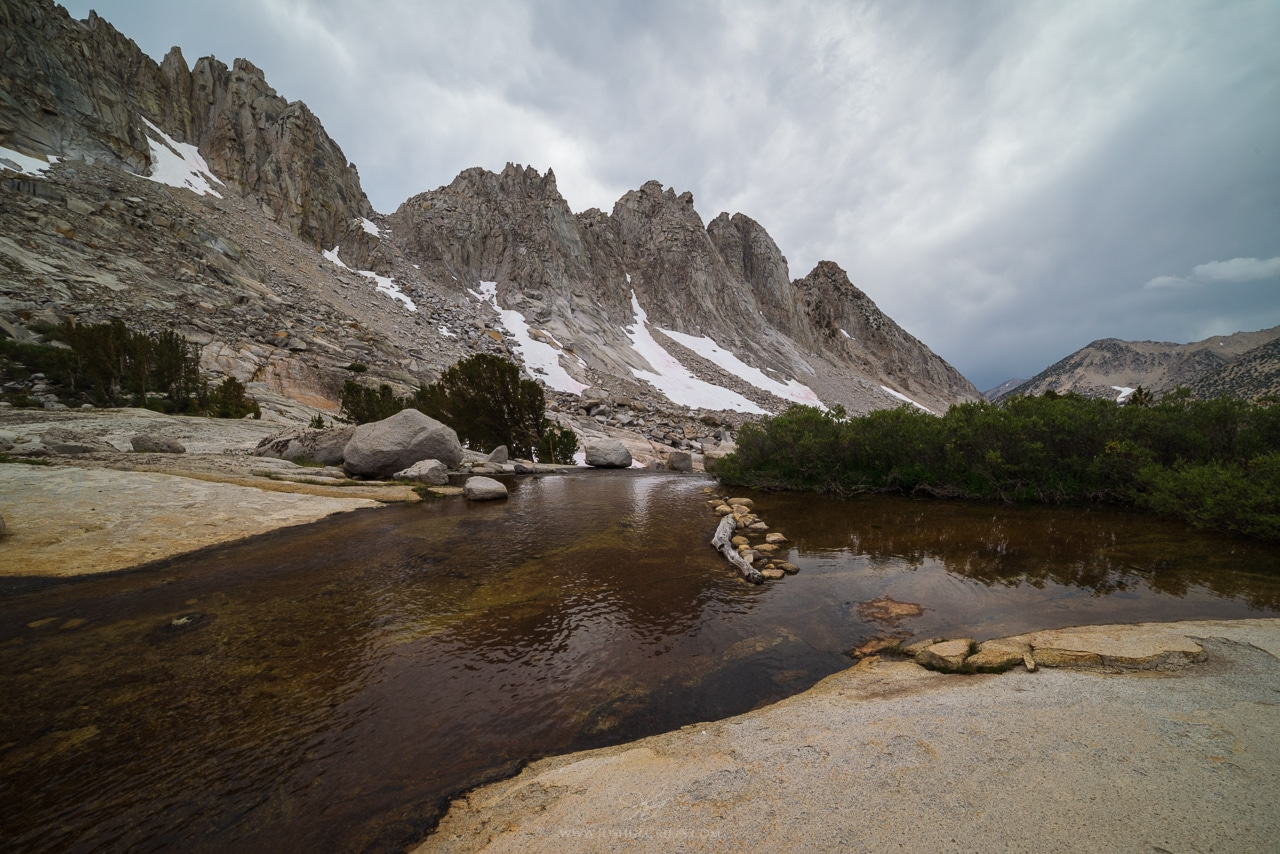 The Kearsarge Pinnacles reflect in a small pool